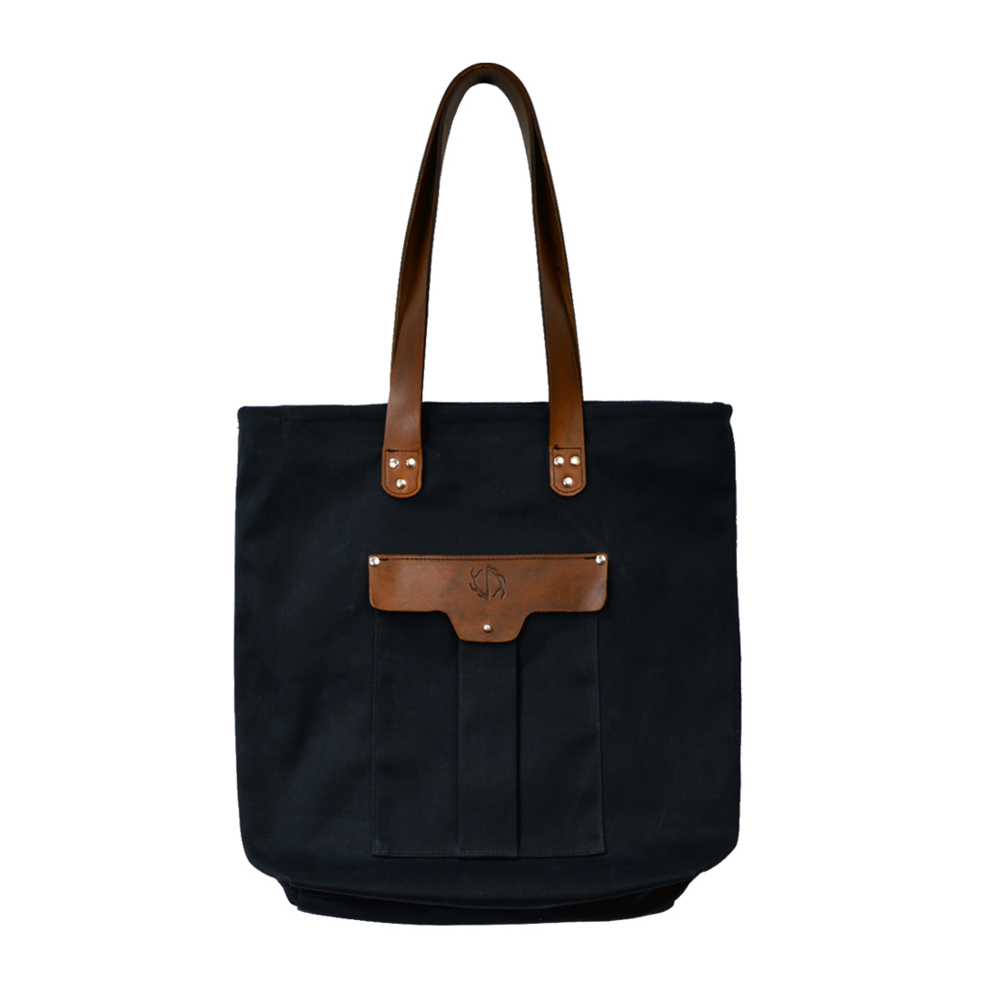 Black waxed canvas tote with brown leather accents