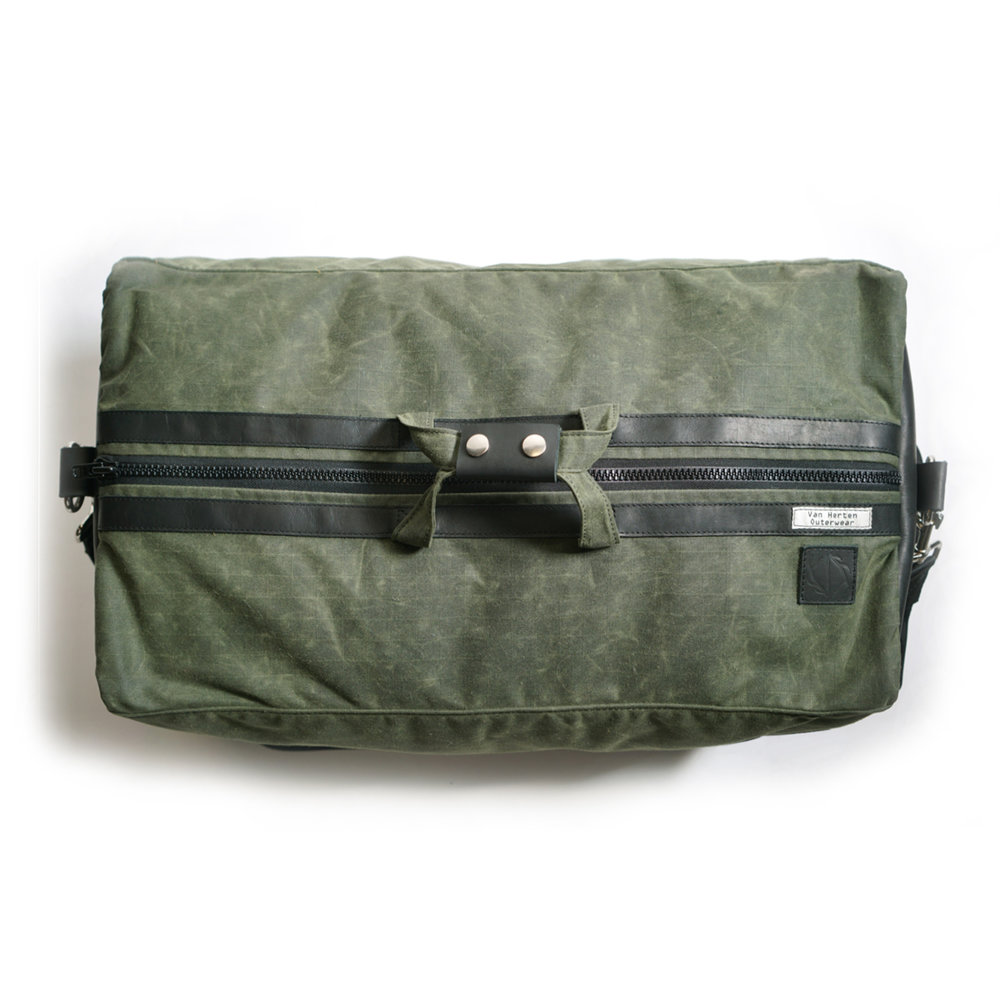 olive waxed canvas and black leather duffle bag