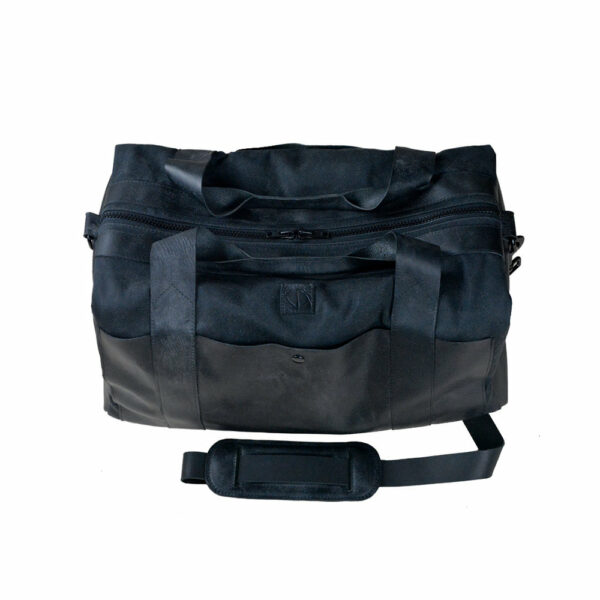 black waxed canvas and leather duffle bag