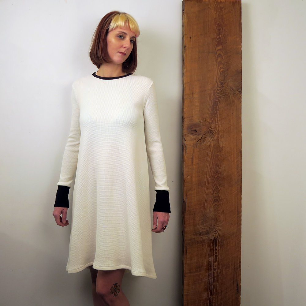 Ivory waffle knit tent dress with black cuffs