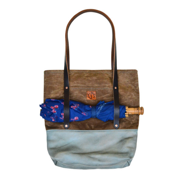 brown waxed canvas and blue leather bag